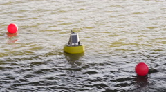 Yellow Buoy with solar panels on it. Stock Footage