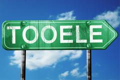 tooele road sign , worn and damaged look - stock illustration