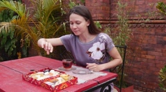 Woman chooses Oriental sweets Stock Footage