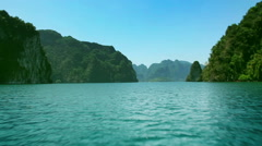 Khao Sok National Park. Sail Boat on lake moving among rock. Asia. Thailand. Stock Footage