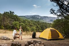 Father with son in the summer camping - stock photo