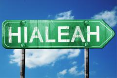 hialeah road sign , worn and damaged look - stock illustration