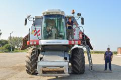 Combine harvester combine operators with a parking lot. Agreecultural machines - stock photo