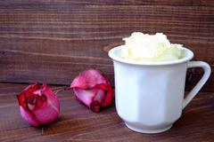 A cup of coffee and a white rose, spring - stock photo