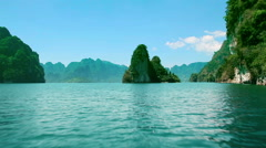 Thailand. Khao Sok National Park. Sailing on the lake among high mountains rock. - stock footage