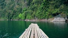 Thailand. Khao Sok National Park. Sail Raft on lake moving among mountains. Stock Footage