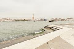 Grand Canal and view of city beyond against sky, Venice, Veneto, Italy Stock Photos