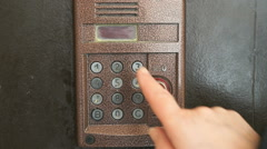 Finger dials apartment old intercom system number Stock Footage