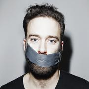 Portrait of man with adhesive tape covering his mouth Stock Photos