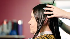 Hairdresser combing hair the client and prepare for haircutting - stock footage