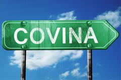 covina road sign , worn and damaged look - stock illustration
