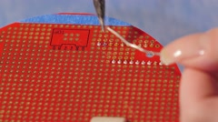 Soldering PCB In The Electronics Lab - stock footage