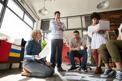 Team of creative people having a meeting Kuvituskuvat