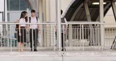 Asian school kids in uniform on skywalk overpass in Bangkok Stock Footage
