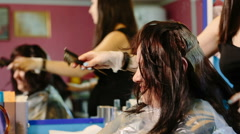Hairdresser dye the hair of the old woman Stock Footage