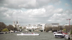 Notre Dame and the Seine wide establishing shot Stock Footage