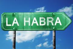 la habra road sign , worn and damaged look - stock illustration