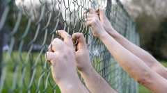 Male, bare hands on wire fance, trying to get out Stock Footage