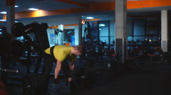 man doing exercises on the buttocks with the rod - stock footage
