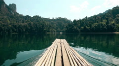 Khao Sok National Park. Sail Raft on lake moving among mountains. Thailand. Stock Footage