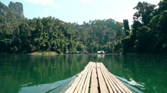 Khao Sok National Park. Sail Raft on the lake moving among camping. Thailand. Stock Footage