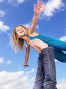 Young girl swirling feet in the air - stock photo