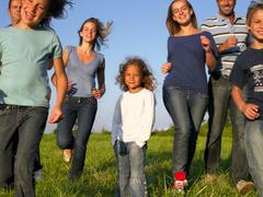 Group of people and children running - stock photo