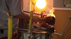 Stock Video Footage of Glass craftsman working with molten glass at Moser glass factory