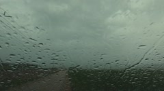 Heavy rain through car window Stock Footage