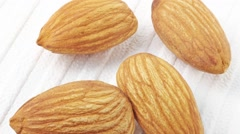 ALMONDS IN CLOSE UP MACRO TRACKING SHOT OVERHEAD Stock Footage