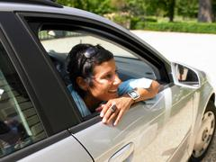 Woman in a car shades Stock Photos