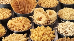 VARIOUS  PASTAS IN CLOSE UP MACRO TRACKING SHOT OVERHEAD Stock Footage