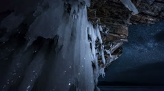 Rotating star sky at night. View through ice cave. Stock Footage