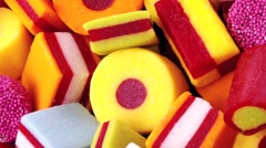 LICORICE ALLSORTS IN CLOSE UP MACRO TRACKING SHOT OVERHEAD Stock Footage