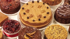ASSORTED CAKES  IN CLOSE UP TRACKING SHOT  - stock footage