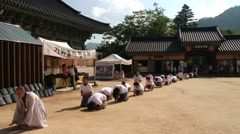 Pilgrims approach Haeinsa Buddhist temple in Haeinsa, Korea. Stock Footage