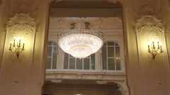High ceiling chandelier in saloon Stock Footage