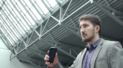 Man answers the call on phone. Slow motion Stock Footage
