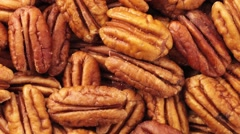 PECAN NUTS IN CLOSE UP TRACKING SHOT OVERHEAD Stock Footage