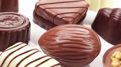 CHOCOLATES IN CLOSE UP TRACKING SHOT OVERHEAD Stock Footage