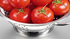 TOMATOES IN CLOSE UP TRACKING SHOT OVERHEAD Stock Footage