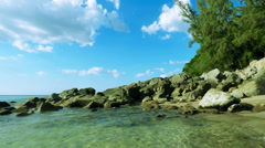 Thailand. Beautiful view on tropical beach. .Stones in water. Stock Footage