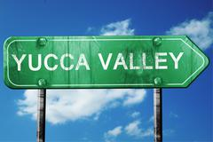 yucca valley road sign , worn and damaged look - stock illustration
