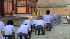 Pilgrims approach Haeinsa Buddhist temple in Haeinsa, Korea. Stock Footage