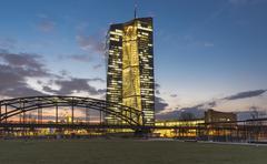 Stock Photo of Brightly lit European Central Bank ECB at dusk blue hour Harbor Park Frankfurt