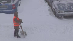 Worker with snow shovel in winter Stock Footage