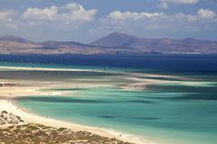 Beach and turquoise sea with windsurfers Playa Risco del Paso Playa de Stock Photos