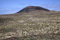 Barren landscape and volcanic mountain Arena in Villaverde Fuerteventura Canary - stock photo