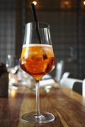 Close-up of aperitif cocktail in wineglass on wooden table Stock Photos