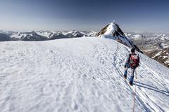 Mountaineer ascent to the summit ridge of the Wildspitze northeast ridge Venter - stock photo